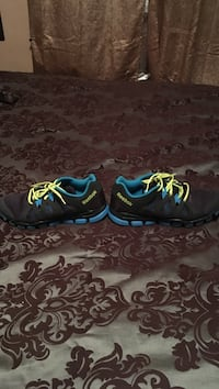 pair of blue-and-black Reebok running shoes
