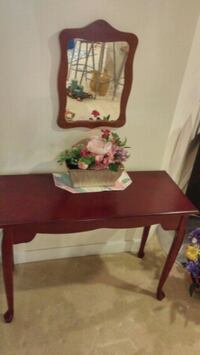 Vanity with mirror and flower arrangement Columbia, 21045