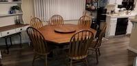 oval brown wooden table with four windsor chairs dining set San Marcos, 92069