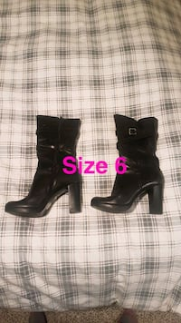 pair of black leather heeled boots Red Deer, T4R 0E6