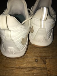Pair of white Nike Paul George  basketball shoes