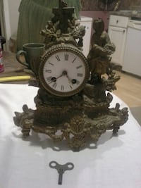 Swiss solid brass sculptured clock