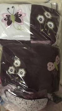 Black and white floral textile for baby's crib