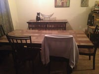 rectangular brown wooden table with six chairs din Laval, H7N 4G1