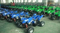 blue and green ATV's lot