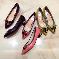 two pairs of black and red leather pointed toe pumps Toronto