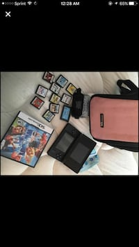 Nintendo DS with game cases Falling Waters, 25419