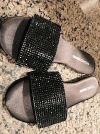 pair of black slide sandals - brand new with box Burnaby, V5G 1N2