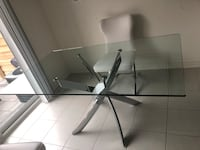 Gray metal base glass top table without the chairs  Vaughan, L0J 4H8