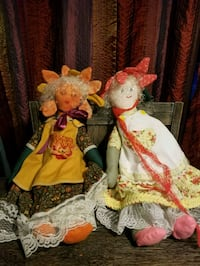 two white and red dressed porcelain dolls Ocala, 34476
