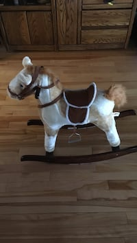 rocking horse with sounds and the tail wags.  Price was $35 Calgary, T2G 0N9