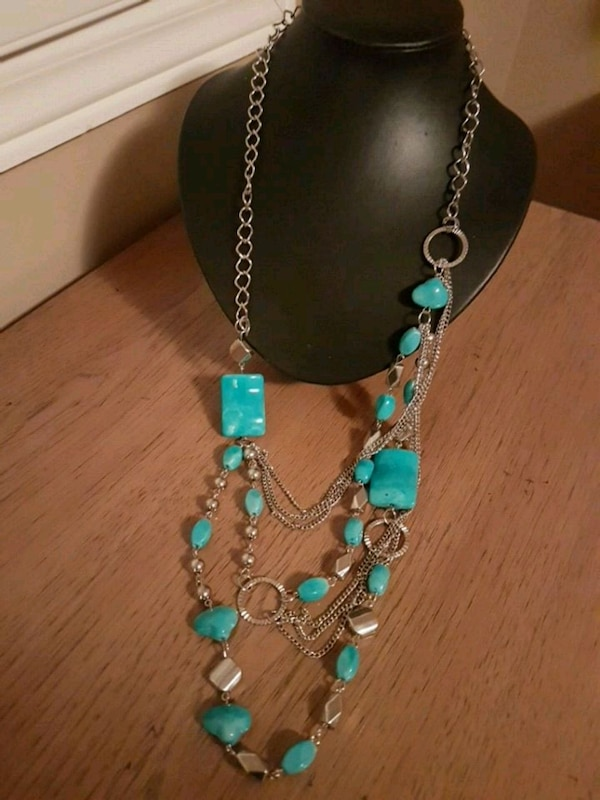 Turquoise stone and silver colored bead necklace
