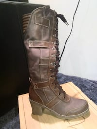 unpaired brown leather knee-high boot Rochester