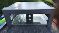 Black wooden framed glass top tv stand Mono