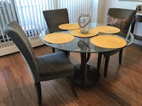 Moved  to Vancouver! Final weekend available !!! My sister has it Fabulous thick heavy glass round table dining set seats 5 with beautiful olive toned fabric dining chairs! no scratches, chips or marks like new beautiful condition!!! paid $2000