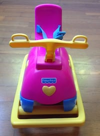 pink and yellow Fisher-Price ride on toy