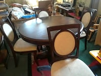 round brown wooden table with four chairs dining set St. Catharines, L2S 1C1