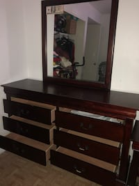 brown and black wooden dresser with mirror Houston, 77092