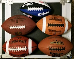 5 NEW (never used) FOOTBALLS. CHEAP!!! CLEARING MY CLOSET OUT!!!