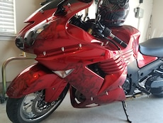 red and black Kawasaki sports bike