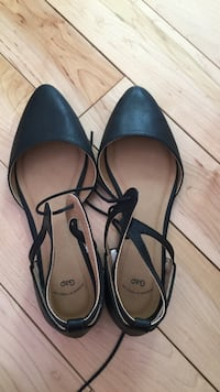 Women's pair of black-and-brown leather sandals size 6
