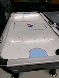 white and gray air hockey table