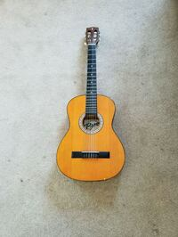 brown and black dreadnought acoustic guitar Vancouver, V6S 2B9