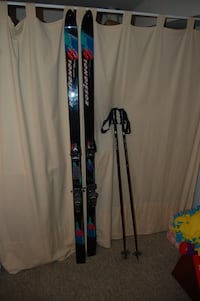 black-and-red Rossignox ski blades with ski sticks Rockville, 20853