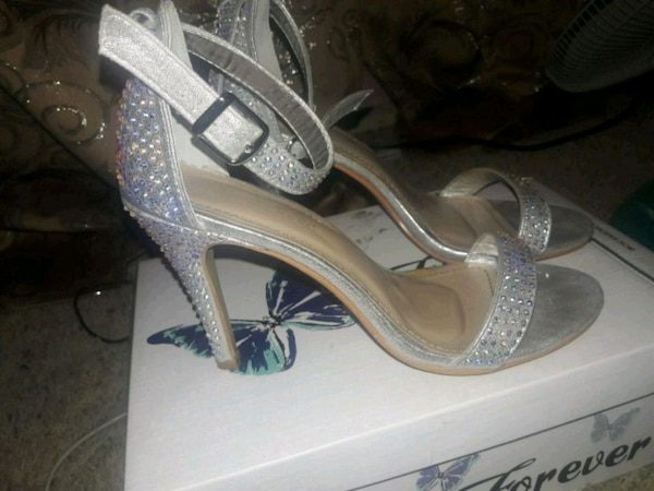 pair of gray open-toe ankle strap heels