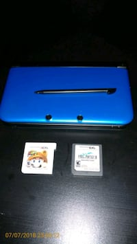 blue Nintendo DS with game cartridges Gibsonton, 33534