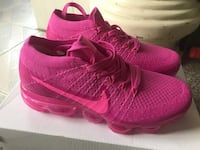 pair of pink Nike running shoes Silver Spring, 20901