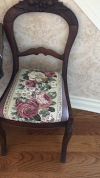 brown wooden framed white and red floral padded armchair