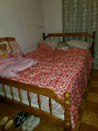 brown wooden bed frame and red bed sheet Vienna, 22182