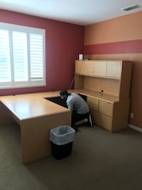 Large office desk with file cabinets that lock and shelving null