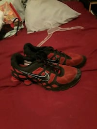 size 12 Nike shocks red and black
