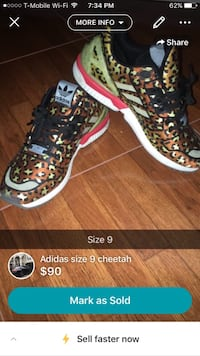 pair of black, brown, and green Adidas camouflage sneakers