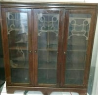 brown wooden framed glass display cabinet null