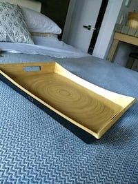 brown wooden bed frame with mattress
