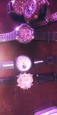 three round silver-colored analog watches Edmonton, T6C 2Z7