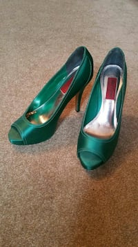 pair of green leather open-toe heels