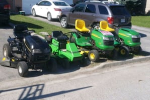 green and black ride on lawn mower