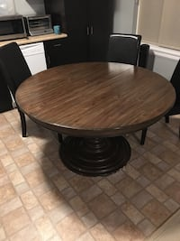 Solid wood dining table. Has leaf. Seats 6. Please note that the low price reflects a crack in the base that can be fixed. The table wobbles slightly   Abbotsford, V4X 0A6