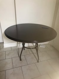 Round dark brown table Brampton, L6S 5Z6