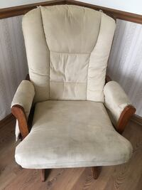 white velvet armchair with brown wooden base