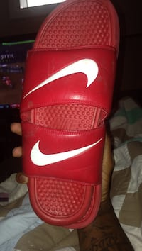 pair of red Nike slide sandals Cleveland, 44122