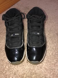pair of black Air Jordan 11's Washington, 20002