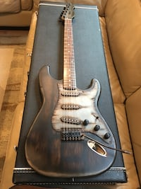 black and gray electric guitar