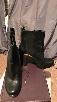 pair of black leather knee-high boots Great Neck, 11024