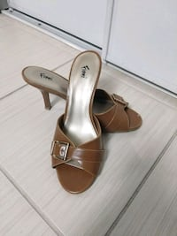 pair of caramel open toe heels