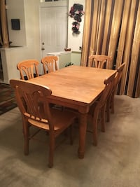 rectangular brown wooden table with four chairs dining set Rockledge, 32955